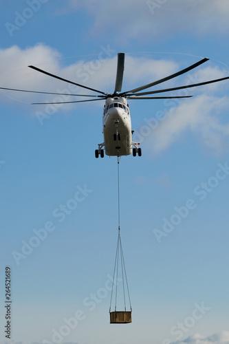 Fotografie, Obraz  Transport helicopter Mi-26 TC Transfers load on the external suspension