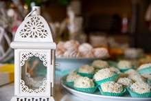Ornamentation With A Metal Lantern And Sweets In A Platter, Background Bokeh