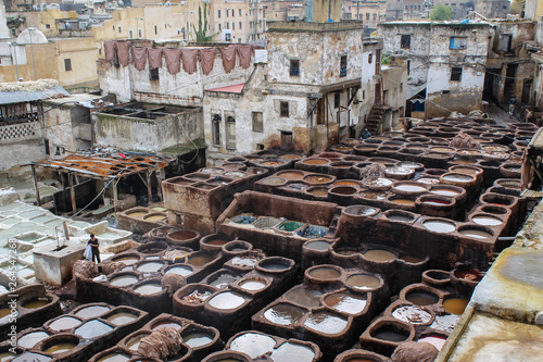 FEZ, MOROCCO - November 1, 2012: Leather dying in a traditional tannery in the city Fez, Morocco