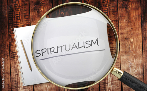 Valokuva  Study, learn and explore spiritualism - pictured as a magnifying glass enlarging
