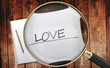 Study, learn and explore love - pictured as a magnifying glass enlarging word love, symbolizes analyzing, inspecting and researching the meaning of love, 3d illustration
