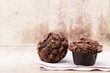 Leinwandbild Motiv Homemade muffins with chocolate, vintage background.
