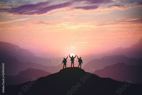 Fototapeta Silhouette of the team on the mountain obraz na płótnie