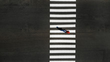 One Pedestrian Crossing Zebra ...