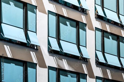 Fotografie, Obraz closed  sun blinds on building facade , modern sunshades / awnings