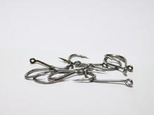 Closeup And Macro Shot Of Fishing Accessories, Fishing Hock And Fishing Swivel With White Background.