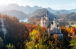 Leinwandbild Motiv Summer Germany. Morning in the Bavarian Mountains. Castle Neuschwanstein in the light of the rising sun. Awesome alpine highlands in sunny day.  Popular Photography Locations. Beautiful of the world