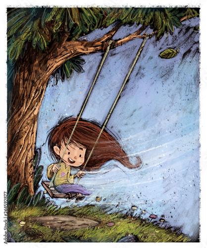 niña jugando en un columpio