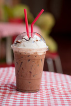 Iced Chocolate Cocoa And Whip Cream On Top With Red Tubes