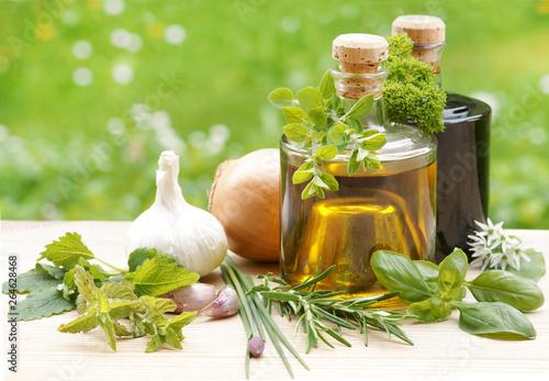 Fototapeta herbs with oil and vinegar, copy space obraz