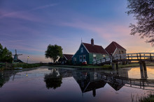 Sunrise At The Zaanse Schans With Classic Dutch Architecture Green Wooden Buildings At The Cheese Factory With Bridge