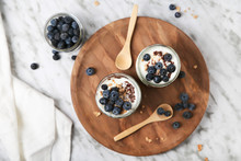 Chia Pudding Parfait With Chocolate And Yoghurt With Blueberries And Granola In Jars