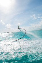 Maldives, Man On Flyboard Above The Sea