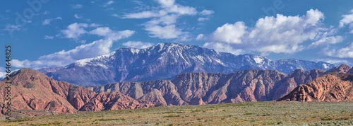 Photo  Views of Red Mountain Wilderness and Snow Canyon State Park from the  Millcreek Trail and Washington Hollow by St George, Utah in Spring bloom in desert