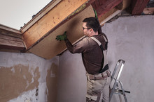 Roof Insulation, Worker Placing Insulating Board, Wood Fiber