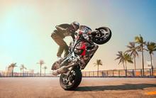 Moto Rider Making A Stunt On H...