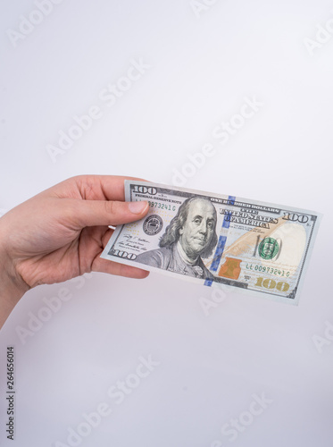 Fotografia  Hands holding American dollar banknotes and Turksh Lira banknotes side by side
