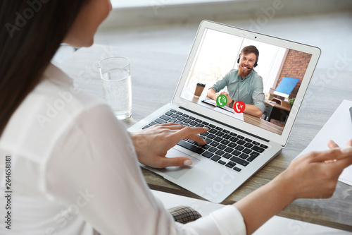 Obraz Woman having video chat with colleague at table in office, closeup - fototapety do salonu