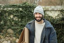 Poor Homeless Man With Cardboard On Street