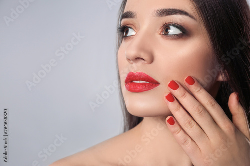 Fototapety, obrazy: Beautiful woman with stylish nail polish on grey background, space for text