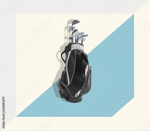 Golf equipment and black golf bag  on a colorful background, top view. Trendy minimal style with colorful paper backdrop.Minimal style. Minimalist Fashion photography