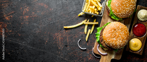 Fototapeta Burgers with fries and various sauces. obraz