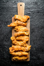 Chicken Strips On A Wooden Cut...
