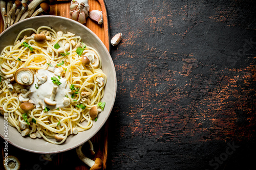 Pasta with mushrooms and sauce in a plate. Canvas Print
