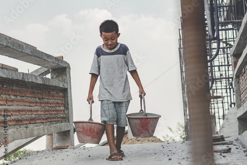 Children working at construction site for world day against child labour concept Canvas Print