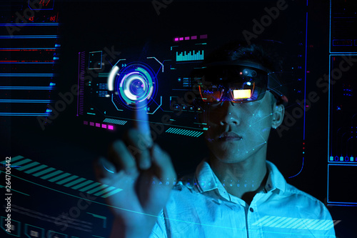 Business man try vr glasses hololens in the dark room | Portrait of young asian Canvas Print