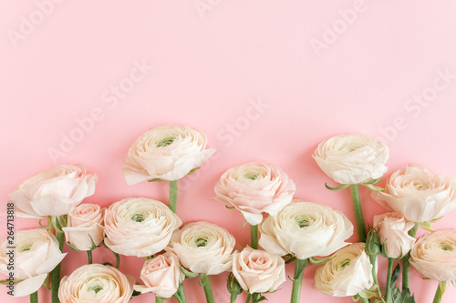 Canvas Prints Floral Pastel pink ranunculus flowers bouquet on pink background. Minimal floral concept. Flat lay, top view.