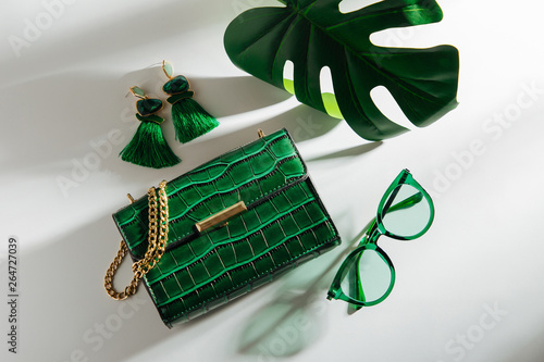 Obraz Feminine accessories collage with handbag, sunglasses and tropical leaf. Flat lay, top view. Summer fashion concept - fototapety do salonu