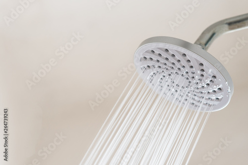 Fotografie, Obraz  Close up of a Shower head with running water