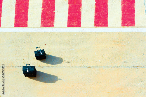 Two suitcases on a platform. Top view Canvas Print