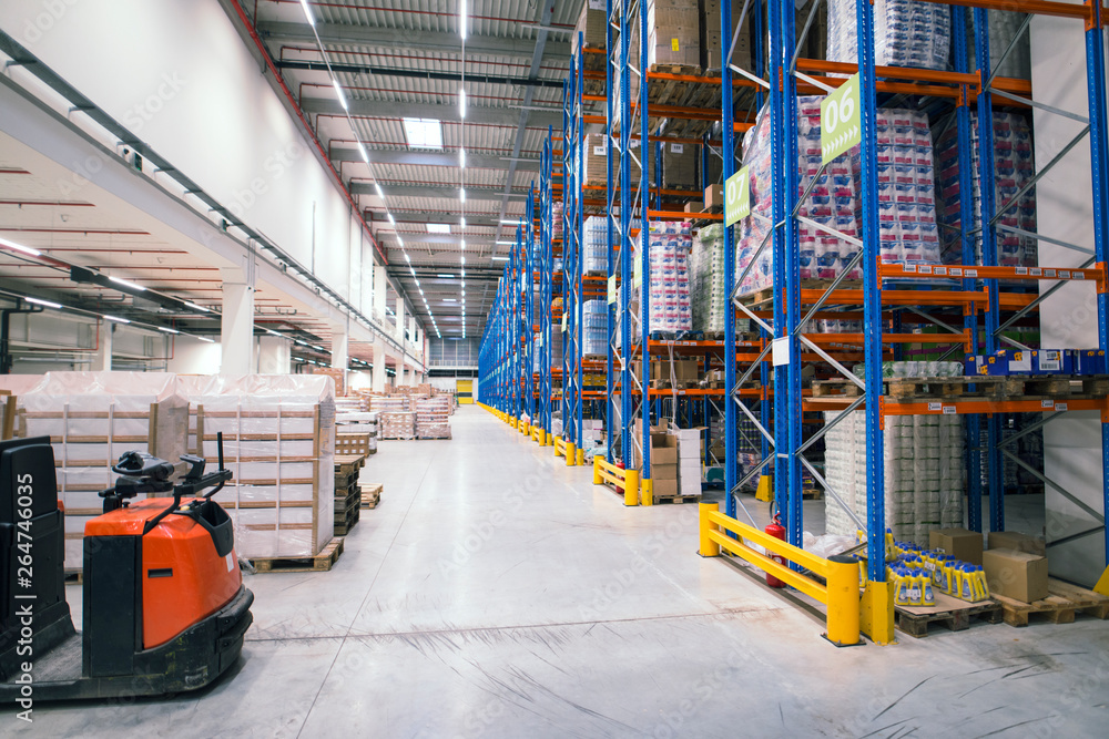 Fototapety, obrazy: Warehouse storage facility interior. Large distribution center with shelves full of palette boxes and forklift machine.