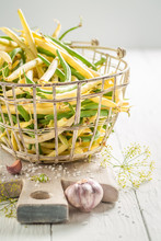Yellow And Green Beans In Old Basket