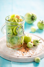 Closeup Of Natural Pickled Green Tomatoes In The Jar