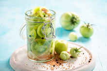 Closeup Of Healthy Pickled Green Tomatoes In The Jar