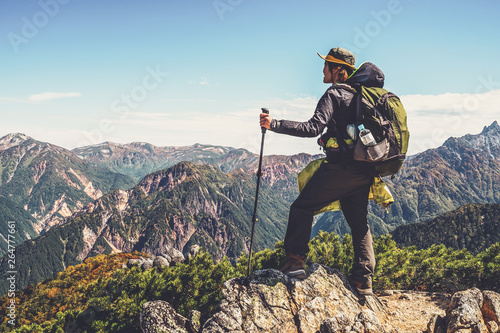 Fototapeta Epic adventure of hiker do trekking activity in mountain of Northern Japan Alps, Nagano, Japan, with panoramic nature mountain range landscape. Motivation leisure sport and discovery travel concept. obraz