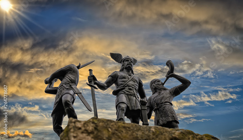 Old Norse God Odin on a rock, flanked by two Vikings (toy soldiers), one of them Canvas Print