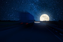 Track In Motion Blur On Highway, Fast Delivery Anywhere In The World, Night Road With Moon And Stars In Sky