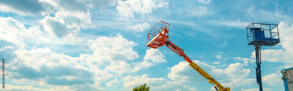 Fototapety, obrazy: Cherry pickers on blue sky background