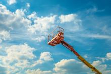 Cherry Picker On The Blue Sky Background