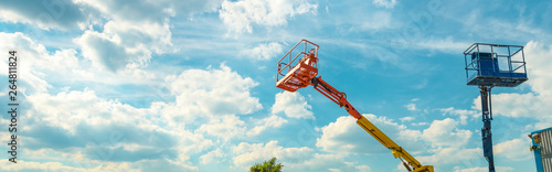 Fototapeta Cherry pickers on blue sky background obraz