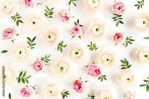 Foto op Plexiglas Bloemen Floral background texture made of pink ranunculusand rose flower buds and eucalyptus leaves on white background. Flat lay, top view floral background.