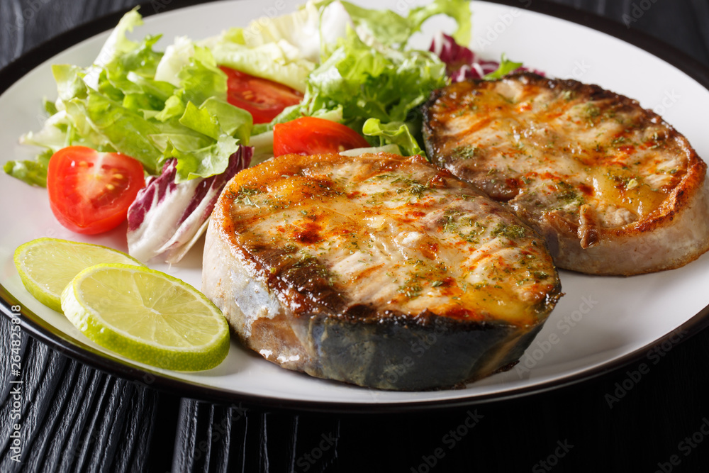 Fototapety, obrazy: fried sturgeon steaks served with fresh vegetable salad close-up on a plate. horizontal