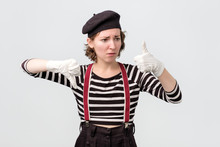 Mime Making Good Or Bad Sign Showing Thumb Up Making A Choice.