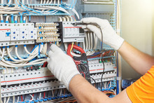 A Closeup Of An Electrical Engineer Working In A Power Electrical Panel