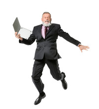 Jumping Mature Man With Laptop...