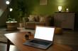 Leinwandbild Motiv Modern laptop on table in living room at night